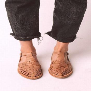 Details: Natural leather sandal with braided detail on top and buckle ankle strap. Color: Natural